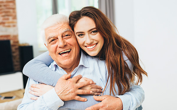 Grandfather & granddaughter smiling